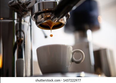 porta filter espressomachine in front of bright background