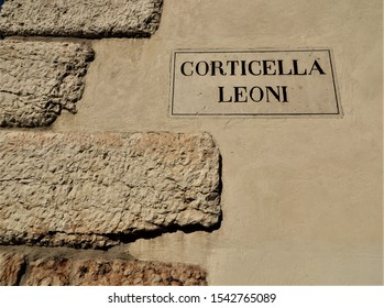 Porta Leoni, old imperial Roman gate in Verona, Italy, dating from the first century BC.  There is a small archaeological excavation of the old Roman town beneath the street of the modern city.