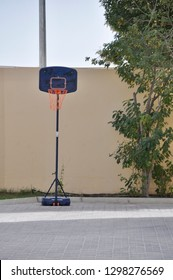 Portable Basketball Hoop isolated in a courtyard - conceptual image