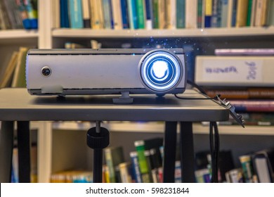 Portable beamer projector used on an office during presentation of bussines results
