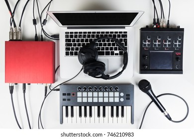 Portable and compact music home studio for electronic and beat music production. Top view of modern music recording set up with professional audio devices