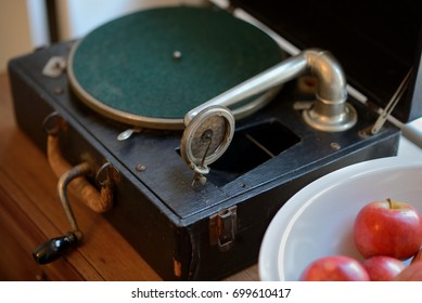 Portable Gramophone record player with Apples in white bowl