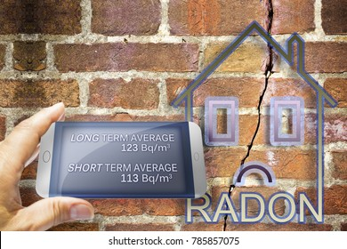 Portable information device for monitoring radioactive gas radon - concept image with home and cracked wall
