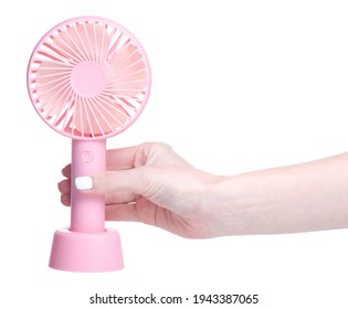 portable mini fan in hand on white background isolation