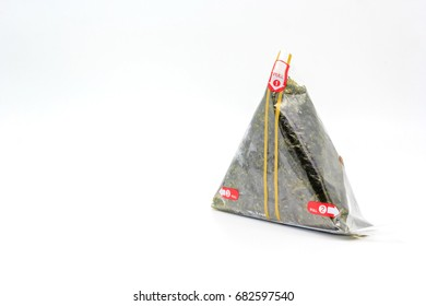 Portable Onigiri a Japanese rice ball wrapped with seaweed in sealed plastic on white background, with Copy space and text.