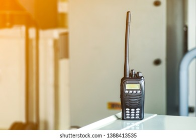 Portable radio transceiver with blurred background for professionals or personal usage. Portable walkie talkie. Communication device,coppy space