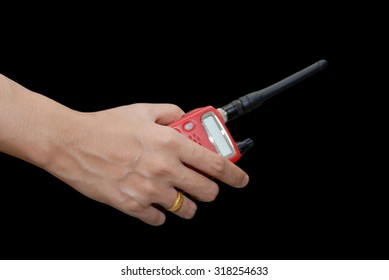 portable radio transceiver in hand, isolated on black background