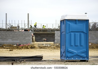 A Portable Toilet at a Construction Site