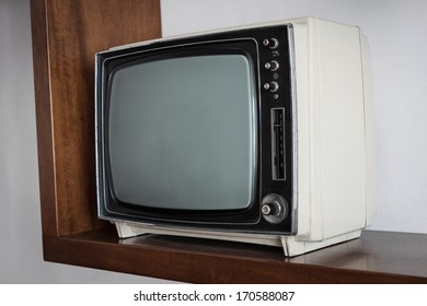 Portable vintage television on a shelf