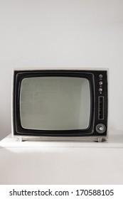 Portable vintage television on white background