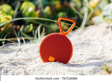 Portable wireless speaker on the beach