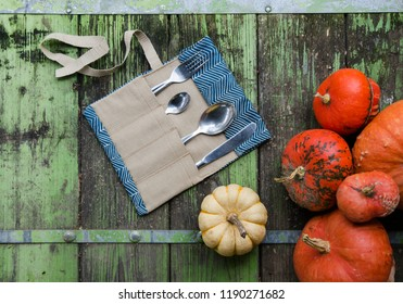 Portable zero waste cutlery kit with vintage autumn style background