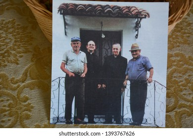 PORTACOMARO D'ASTI, ITALY - MARCH 12, 2014: Pope Francis (third from the left) and some friends in a old photo taken in Portacomaro and shown into the old house-museum of his relatives, open for free.