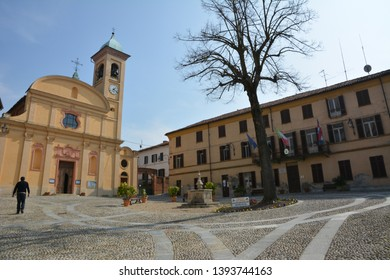 PORTACOMARO D'ASTI, ITALY - MAY 5, 2018: The square, the old church and the municipal seat of the village of the distant Italian relatives of Pope Francis.