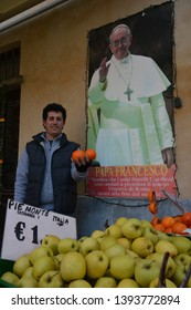 PORTACOMARO D'ASTI, ITALY - MAY 5, 2018: The greengrocer of the town of the distant Italian relatives of Pope Francis has a photo of His Holiness next to the entrance of his shop.