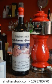 """PORTACOMARO D'ASTI, ITALY - MAY 5, 2018: A special bottle of red wine of Monferrato (only one specimen) named """"Habemus Papam"""", bottled when Pope Francis was elected. It is kept in a bar in the village"""