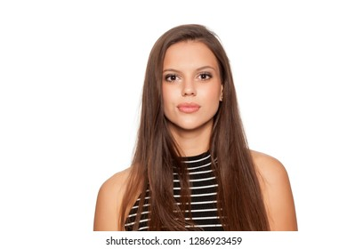 portait of beautiful young brunette on white background