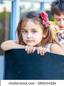 portait little girl at ice cream cafe