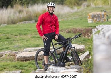Portait of mountainbiker with modern E-Mountainbike