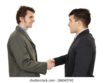 Portait of young business people shaking hands
