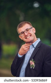 Portait of a young handsome man in glasses and suite. Close up of a gorgeous guy, outdoors