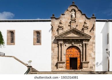 The portal of the church Iglesia Matriz de El Salvador with blue sky in Santa Cruz de La Palma, Spain.