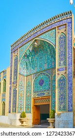 The portal of Imam Zadeh Jafar Shrine is covered with masterpiece tilework in azure and dark-blue gamma with fine floral motives and Quranic calligraphy, Yazd, Iran.