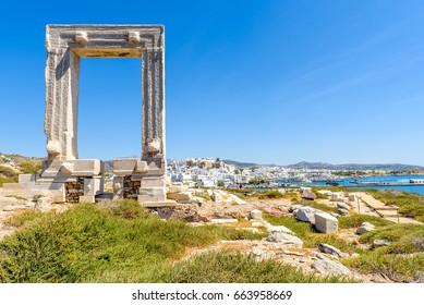 The Portara, one of Naxos most famous landmarks connected to Naxos (Chora) town by a causeway. Cyclades Islands, Greece.