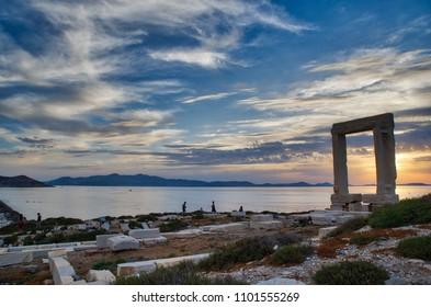 Portara - ruins of ancient temple of Delian Apollo on Naxos island at sunset, Cyclades archipelago, Greece.