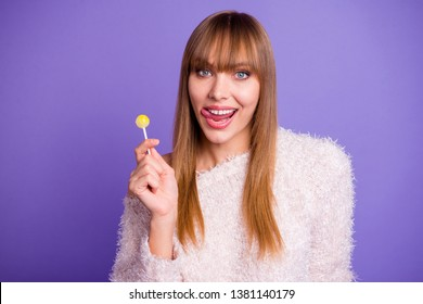 Portarit of chic classy attractive lady hold hand sugary yellow lolipop feel satisfied content positive wear modern woolen outfit isolated on purple background