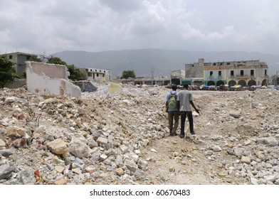 PORT-AU-PRINCE - AUGUST 21: A couple walking through the  rubble , which used to be a building   before the earthquake  at Port-Au-Prince, Haiti on August 21, 2010.