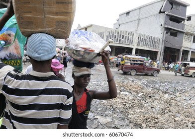 PORT-AU-PRINCE - AUGUST 21: People passing by a  garbage dumping place right in the middle of  Iron Market in  Port-Au-Prince, Haiti on August 21, 2010.
