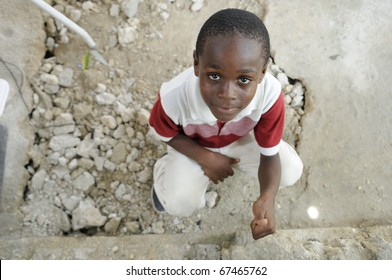 """PORT-AU-PRINCE - AUGUST 22: An unidentified Haitian kid shows a """"thumb up"""" sign during a food distribution camp in Port-Au-Prince, Haiti on August 22, 2010."""