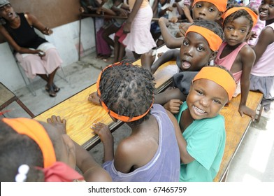 PORT-AU-PRINCE - AUGUST 25:  unidentified Haitian children of  a small school in Cite Soleil- one of the poorest area in the western hemisphere , in Port-Au-Prince, Haiti on August 25, 2010.
