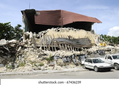 PORT-AU-PRINCE - AUGUST 26: Back side of the collapsed Presidential Building  which remains the way it was 7 months before, in Port-Au-Prince, Haiti on August 26, 2010.