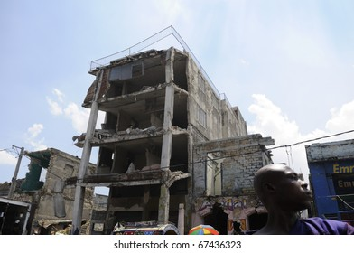 PORT-AU-PRINCE - AUGUST 27: A Haitian traveling on a tap-tap in the downtown of the capital where most of the affected buildings still remain in a risky , in Port-Au-Prince, Haiti on August 27, 2010.