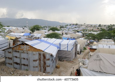 PORT-AU-PRINCE - AUGUST 28:   Damaged Tents are also reconstructed with Tins instead of plastic as plastic tents are expensive,  on August 28, 2010 in Port-Au-Prince, Haiti