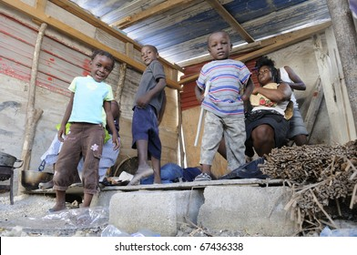 PORT-AU-PRINCE - AUGUST 28: An Haitian unidentified family in their temporary shack to escape from the scorching heat of their actual tent , in Port-Au-Prince, Haiti on August 28, 2010.