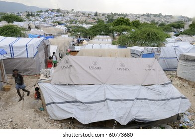 PORT-AU-PRINCE - AUGUST 28:  People walking on the walkways of a tent city, on August 28, 2010 in Port-Au-Prince, Haiti