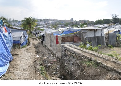 PORT-AU-PRINCE - AUGUST 28:  Residents  of the Tent Cities builds drains and manholes themselves in order to survive during heavy rainfall,   on August 28, 2010 in Port-Au-Prince, Haiti