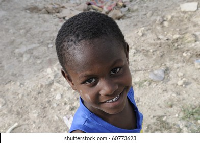 """PORT-AU-PRINCE - AUGUST 28:  A small unidentified kid during his leisure time  in the Tent city called """" ACRA""""on August 28, 2010 in Port-Au-Prince, Haiti"""