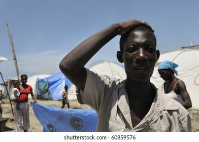 PORT-AU-PRINCE - AUGUST 28:  A young man who sells ice cubes in the tent cities explaining his situation in one of the tent cities  in  Port-Au-Prince, Haiti on August 28, 2010.