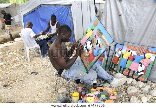 PORT-AU-PRINCE - AUGUST 31:  An artist painting images and on the background  kids playing chess- a typical example of Social contrast, in Port-Au-Prince, Haiti on August 31, 2010.