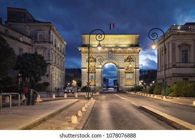 The Porte du Peyrou -  a triumphal arch in Montpellier, France at dusk