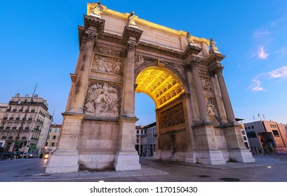 Porte Royale - triumphal arch in Marseille, France. Constructed in 1784 - 1839. Inscription on arch in French: To the Republic . Grateful Marseille.
