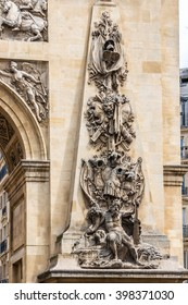 The Porte Saint-Denis, built in 1672, was designed by architect Francois Blondel at the order of Louis XIV. Bronze inscription LUDOVICO MAGNO (To Louis the Great). Paris, France.
