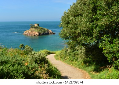 Portelet Bay, Jersey, U.K. Bay view with a 19th century tower on an island.