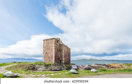 Portencross Castle on a clear day with blue sky's and the Cmbrae's and Arran in the back ground.