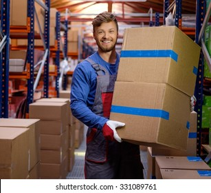 Porter carrying boxes in a warehouse