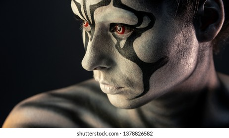 porter girl in the makeup of a mystical creature black white fiery red eyes, conceptual image